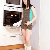 Boots outfitted brunette amateur Lolly unsheathing little nubile knockers and provocative butt in kitchen