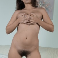Brunette amateur Camille S showcasing smallish melons before parting fur covered slit