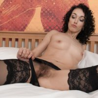 Dark haired amateur Cleo Dream loosing beguiling legs from stockings before spreading fuckbox