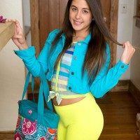 Black-haired amateur Natalie Monroe revealing small teen hooters and magnificent ass under spandex pants
