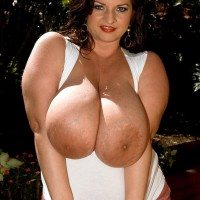 Dark haired stunner Maria Moore loosing immense boobs outdoors in shorts