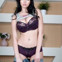 Brunette babe Sha Rizel releasing hefty all natural hooters from lavender lingerie