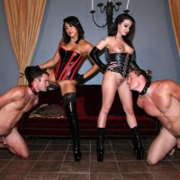 Black-haired Dominatrixes Adriana Lynn and Mia Li manhandle collared and naked man submissives