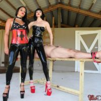 Dark haired Mistresses Jean Bardot and Michelle Lacy dominate dude on bondage table