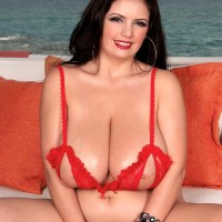 Dark-haired MILF Arianna Sinn sets her large melons free of her letting out bra