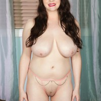 Dark haired MILF Kate Marie revealing gigantic all natural hooters while undressing