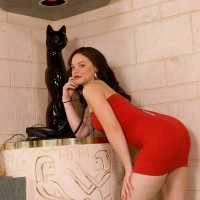 Brown-haired MILF Leenuh Kai revealing flawless bum and cooch underneath red sundress