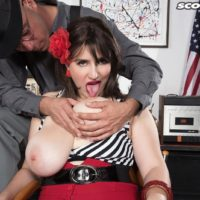 Dark-haired MILF May West having giant hooters and stiff hard nipples exposed by boy in hat