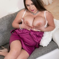 Dark-haired MILF Monica Enjoy letting massive breasts free from melon-holder and dress in high-heels