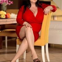 Dark haired MILF Natalie Fiore exposing hefty hooters and flaunting upskirt underwear