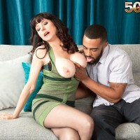 Brown-haired MILF over 50 Karen Kougar seducing younger boy for sex on couch