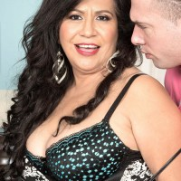 Dark-haired MILF over 50 Victoria Versaci unveiling enormous butt while being undressed