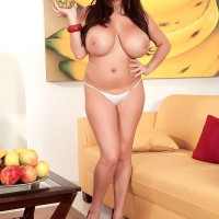 Dark-haired MILF pornographic starlet Leanne Crow unveiling monster-sized tits in high heels and miniskirt
