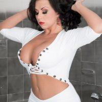 Dark-haired MILF adult vid starlet Sheridan Love loosing ideal hooters and pierced nipples in bathroom