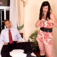 Brunette MILF XXX video star Terry Nova delivering handjob and blowjobs in fishnet body-stocking