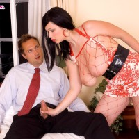 Brunette MILF XXX video star Terry Nova delivering handjob and blowjobs in fishnet body-stocking