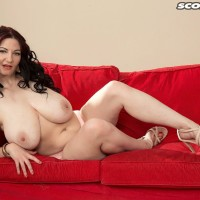 Brown-haired MILF porno starlet Vanessa Y letting huge all natural fun bags free in stilettos
