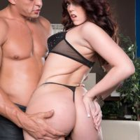 Dark haired MILF Ryan Smiles vaunting giant ass in thong panties and high-heeled shoes