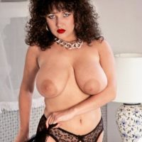 Brunette MILF Stacey Owen puts her big titties on show in garters and hosiery