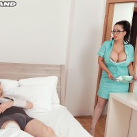 Dark haired MILF Tigerr Benson letting out large hooters before having sex on medical center bed