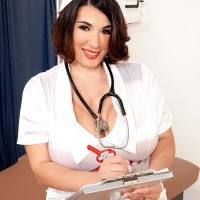 Brown-haired nurse Elaina Gregory showcasing her humungous butt and hairy muff in uniform