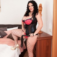 Dark haired solo female Juliana Simms whipping out humungous natural hooters from lingerie
