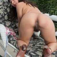 Dark haired solo female Vivi Marie flashing furry armpits and spread fuckbox outdoors
