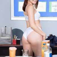 Brown-haired spinner Kylie Quinn unveiling petite breasts on desk in socks and panties