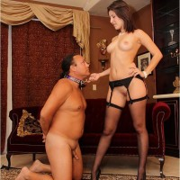 Brunette girlfriend Missy Daniels puts a collar on her male submissive and stomps him