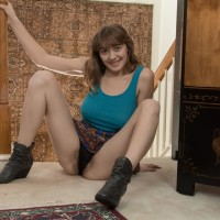 Big-titted amateur Dani exposing large all natural juggs and wooly snatch in boots and skirt
