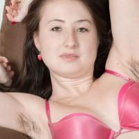 Huge-boobed amateur Megan flashing unshaven armpits and unshaven fuckbox underneath yoga pants