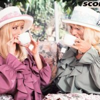 Buxom blond Lisa Lipps and a mistress of a similar description share a lezzie smooch in garden