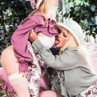 Buxom blond Lisa Lipps and a mistress of a similar description share a lezzie smooch in garden