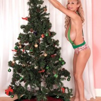 Big-chested ash-blonde MILF Venera flaunting excellent legs in heels by Christmas tree