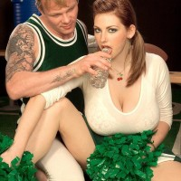 Cheerleader uniform adorned Christy Marks uncovering huge boobs for knocker fucking
