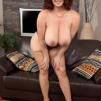 Chubby solo girl Vanessa Y demonstrating hefty natural suspending funbags in pantyhose