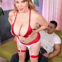 Chubby platinum-blonde XXX pornstar Desiree unsheathing monster-sized tits and giving BJ in nylons