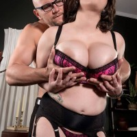 Round stocking and lingerie clad dark haired Alana Lace having gigantic breasts unveiled