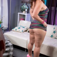 Chunky dark haired chick Peridot showing off large upskirt ass in thong panties and pumps
