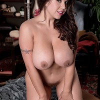 Chubber brown-haired solo girl Sheridan Enjoy unleashing humungous knockers and fur covered cooch