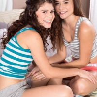 Fully-clothed teen chicks Lexy Lotus and Kharlie Stone tongue kissing in socks