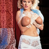Curly yellow-haired Suzanne Brecht unsheathes her large fun bags in lace lingerie and gloves