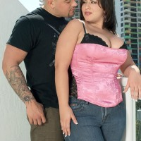 Curvy black-haired MILF London Andrews pulling out boobs for nipple tonguing in jeans