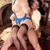 Dark haired stunner Shione Cooper tonguing dick while showcasing super-cute juggs in nylons
