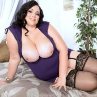 Brown-haired BBW Charlotte Angel sets her immense titties loose of dress and boulder-holder
