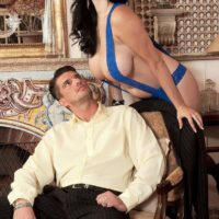 Dark-haired MILF Shione Cooper flashing enormous boobs for nip eating in tights