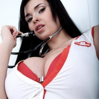 Black-haired nurse Sha Rizel removes her uniform to pose in her bra and skivvies