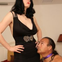 Brunette mistress Shae fatale hog ties her male before undressing to her lingerie and stilettos
