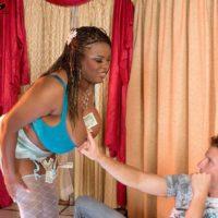 Black stripper Mianna Thomas reveals her huge breasts in hosiery and garters