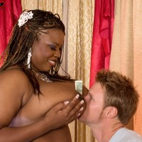 Black stripper Mianna Thomas reveals her huge breasts in hosiery and garters